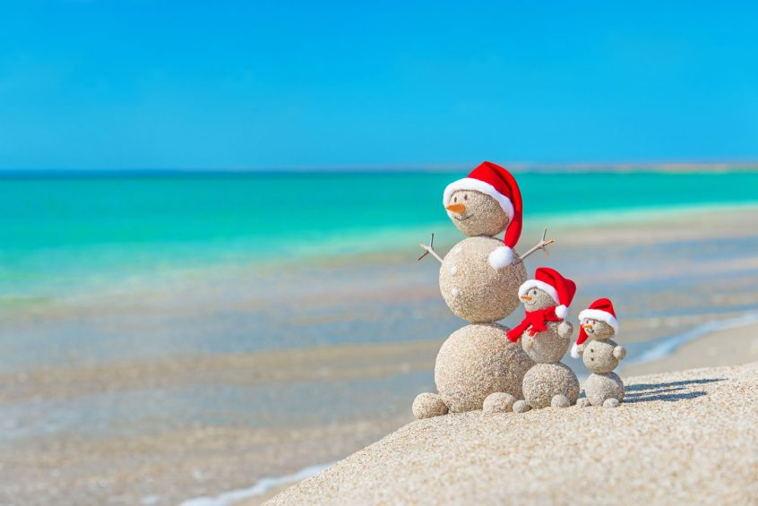 Vacation home rentals on Folly Beach, South Caronlina mean sandmen for snowmen this Christmas.