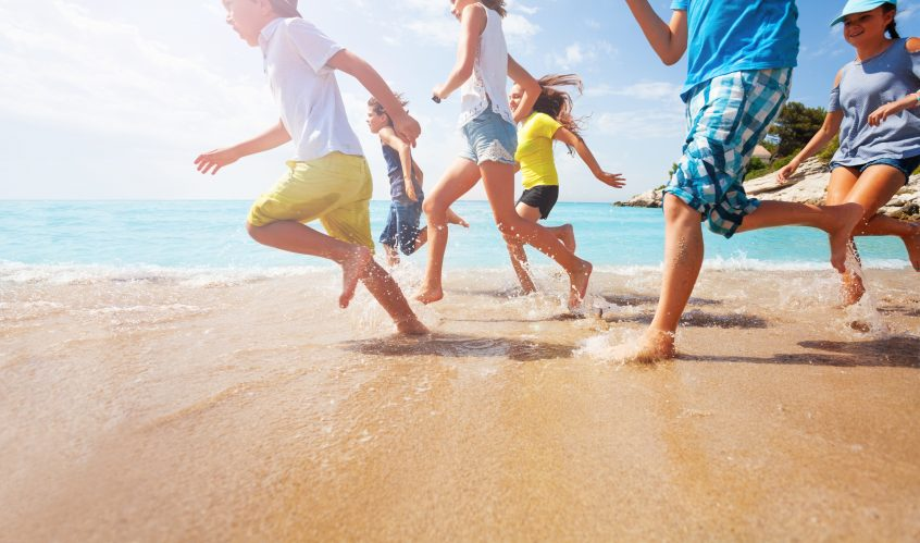 Kids and Teens Running in the Surf on Spring Break